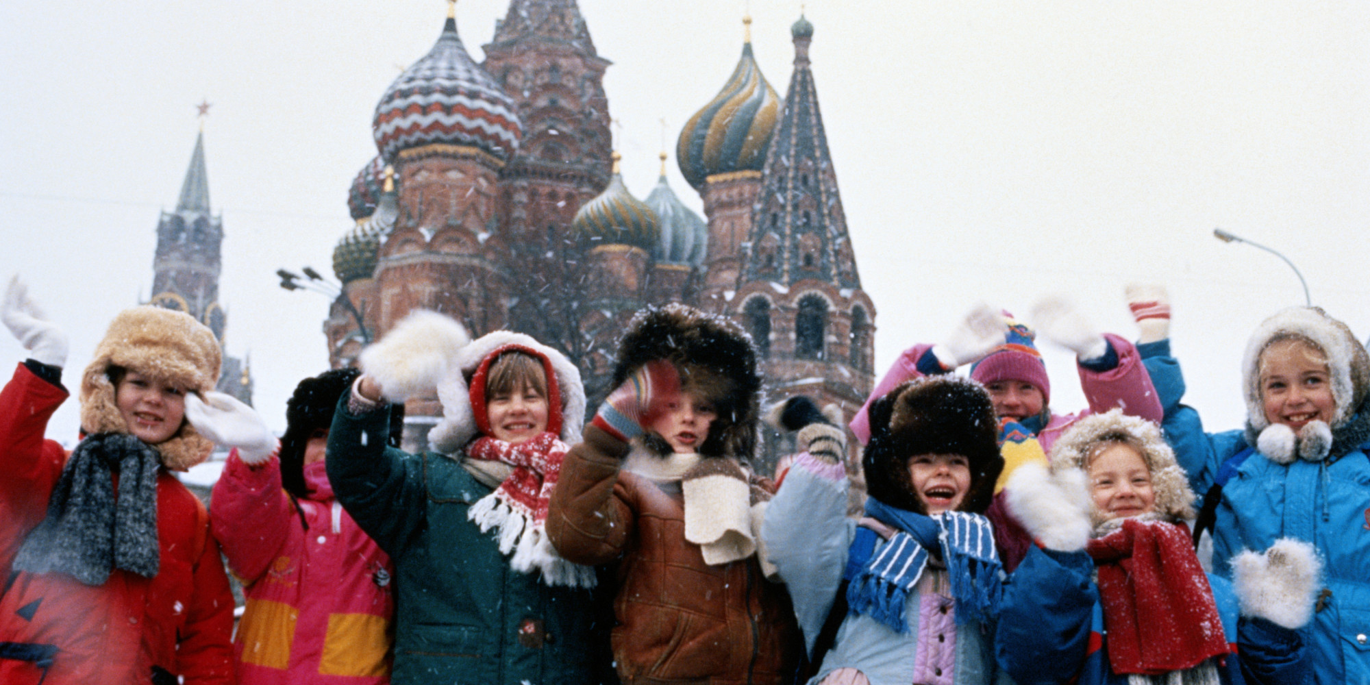 RUSSIAN CHILDREN AT RED SQUARE IN SAINT BASILS